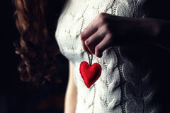 Female hands heart breast love. Female hand holding a heart shape closeup stock images