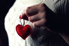 Female hands heart breast love. Hands female holding in a heand heart breast love Stock Images