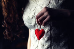 Female hands heart breast love. Object red heart-shaped hands holding a young person royalty free stock photos
