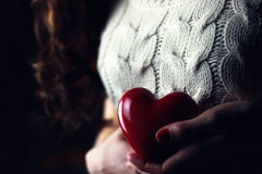 Female hands heart breast love. Various vintage elements on old worn backgrounds different concepts royalty free stock photo