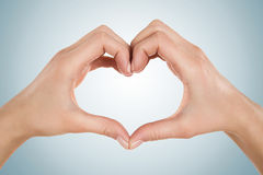 Female hands in heart shape Royalty Free Stock Images