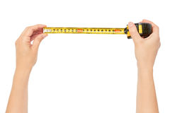 Free Female Hands Hold A Tape Measure To Measure The Size. Isolated On White Background Stock Photo - 97762700