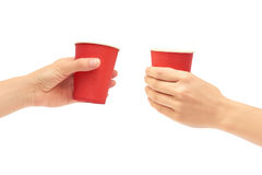 Female hands hold a cardboard or plastic disposable cup. Isolated on white background Stock Photos