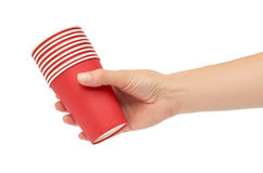 Female hands hold a cardboard or plastic disposable cup. Isolated on white background.  Stock Images