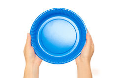 Female hands hold a cardboard or plastic disposable plate. Isolated on white background Royalty Free Stock Photography