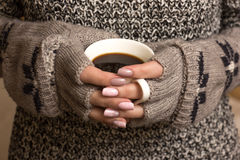 Female hands hold a coffee cup Stock Photography