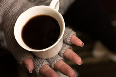 Female hands hold a coffee cup Stock Images