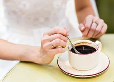 Female hands hold a cup of coffee Stock Photos