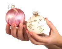 Female hands hold fur-tree spheres Stock Image
