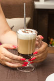 Female hands hold glass cup  mocha coffee Royalty Free Stock Photography