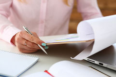Female hands hold silver pen and pad Royalty Free Stock Photography