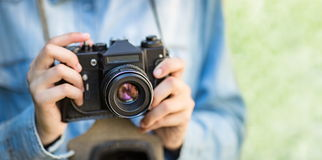 Female hands hold vintage camera Royalty Free Stock Images