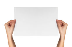 Female hands hold white paper Royalty Free Stock Photos