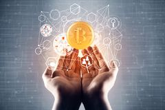 Cryptocurrency concept. Female hands holding abstract bitcoin hologram on blurry circuit hologram. Cryptocurrency concept Stock Photo