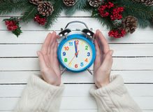 Female hands holding alarm clock Royalty Free Stock Photography