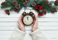 Female hands holding alarm clock Royalty Free Stock Images