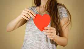 Female hands holding blank empty red Valentines card with heart. Female hands holding black empty red Valentines card with heart on a white background stock photos