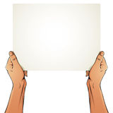 Female hands holding blank paper sheet. Royalty Free Stock Photo