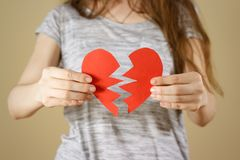 Female hands holding broken blank empty red Valentines card with Royalty Free Stock Images