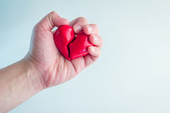 Female hands holding broken heart. From two pieces royalty free stock photography