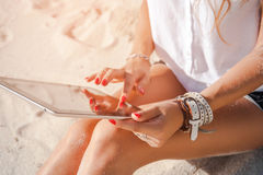 Female hands holding and browsing a digital tablet Stock Images