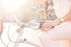 Female hands holding a city bike grips Stock Images