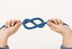 Female hands holding a climbing rope Stock Photos