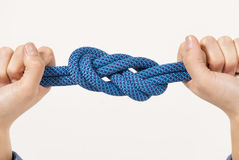 Female hands holding a climbing rope Royalty Free Stock Image