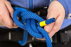 Female hands holding a climbing rope Royalty Free Stock Photography