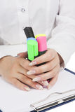 Female hands holding colorful markers Stock Image