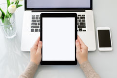 Female hands holding computer tablet with isolated screen near l Royalty Free Stock Photo