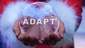 Hands holding planet with text Adapt
