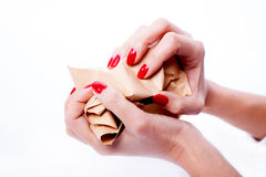 Female hands holding a crumpled paper Royalty Free Stock Photos