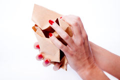 Female hands holding a crumpled paper Stock Image