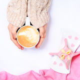 Female hands holding cup of cappuccino. Gift alike dessert with Stock Images