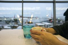 Woman Having Coffee In Airport stock photo