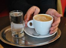 Female hands holding cup of coffee in cafe royalty free stock photos