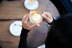 Female hands holding cup with coffee Stock Photo