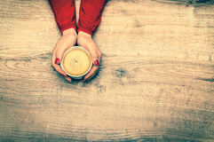 Female hands holding a cup of hot coffee - retro style Stock Photos