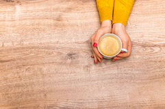 Female hands holding a cup of hot coffee Royalty Free Stock Photo