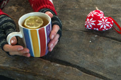 Female hands holding a cup of hot drink Stock Images
