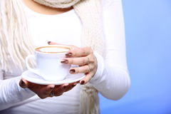 Female hands holding cup of hot latte coffee cappuccino Royalty Free Stock Photo