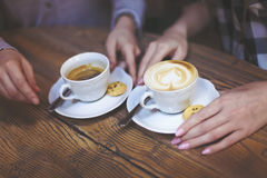 Female hands holding cups of coffee Stock Photos