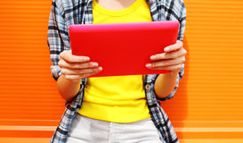 Female hands holding digital tablet pc Stock Photo