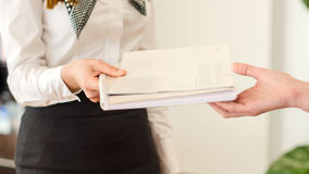 Female hands holding documents. Agreement concept stock images
