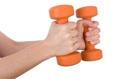 Female hands holding dumbbells Royalty Free Stock Photography