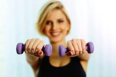 Female hands holding dumbbells Stock Photo