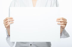 Female hands holding empty paper ready for your content Royalty Free Stock Photo