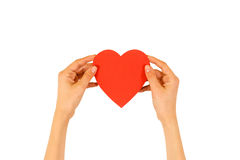 Female hands holding empty red Valentines card with heart on a w. Hite background stock photos