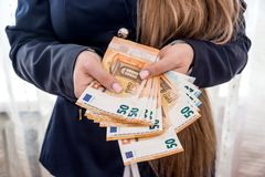 Female hands holding 50 euro banknotes, royalty free stock photos